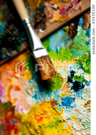 A real brush on the background of oil paints 65430190