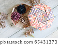 Fashionable Japanese style origami box in calm colors 65431373