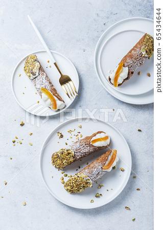 Traditional italian dessert cannoli siciliani 65434644