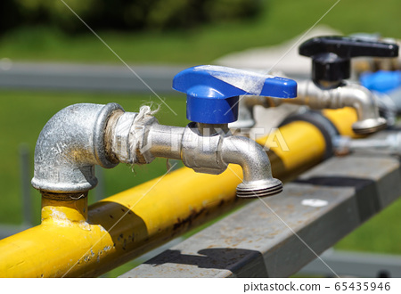 Tap with drinking water, the valve is closed .Water consumption concept. World Water Day 65435946