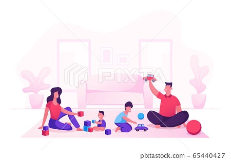 Happy Family with Kids Leisure Time in Evening or Weekend. Father and Mother Playing Toys with Children Sitting on Floor 65440427
