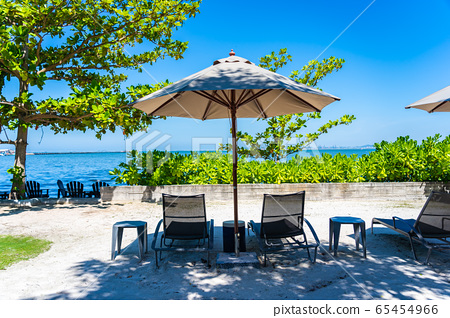 Umbrella and chair on the beach and sea with blue sky 65454966