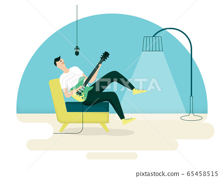 Young man enjoying singing and playing guitar in living room 65458515