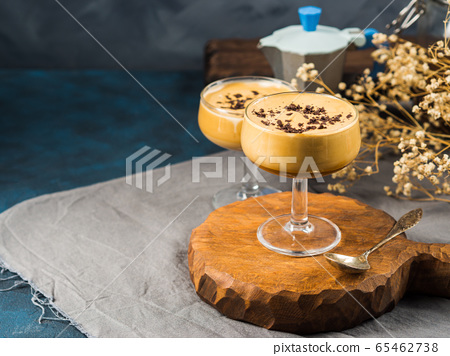 Frappe coffee in dessert glasses on brown backdrop 65462738