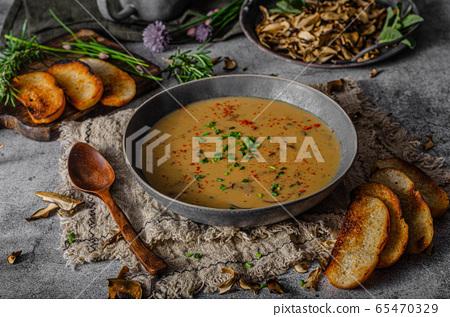 Fox mushrooms soup 65470329