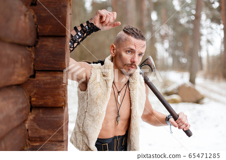 Viking warrior with an ax in a vest of wool  65471285