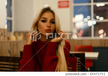 Beautiful young fashionable woman in a red sweater 65471751