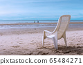 tropical beach background with beach chair on sand 65484271