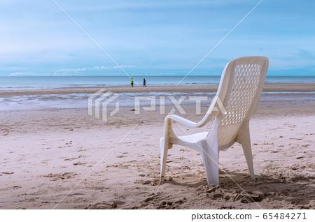 tropical beach background with beach chair on sand 65484271