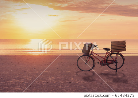 Bicycle on the beach with sunrise sky background, 65484275
