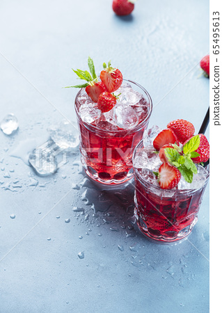 Red cocktail with ice and mint 65495613