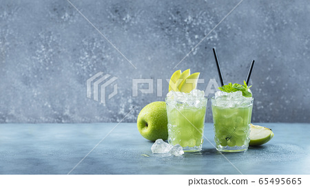 Green cocktail with ice and mint 65495665