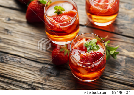Fresh summer cocktail with ice, strawberry and 65496284