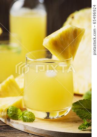 Fresh summer pineapple juice 65496924