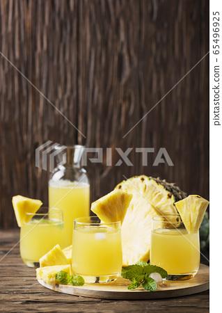 Fresh summer pineapple juice 65496925