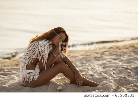 Woman Resting on the Beach During Vacations 65500533