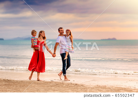 Family with kids on tropical beach. Sea vacation. 65502347