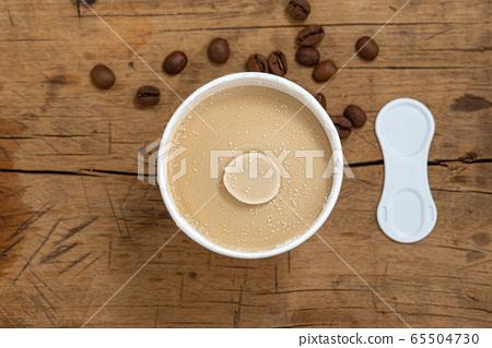 Coffee ice cream cup on wood table 65504730