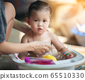 Mother bathes the kid concept. adorable girl in 65510330