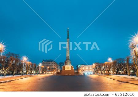 Riga, Latvia. Night View Of Memorial Freedom Monument At Freedom Square In Night Lighting Illumination 65512010