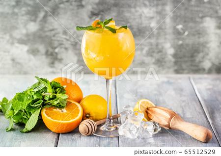 Fresh orange juice mint leaves decoration Summer 65512529