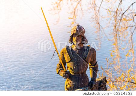 Statue of Bruncvik - legendary Czech knight - near Charles Bridge in Prague, Czech Republic 65514258
