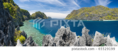 El Nido, Palawan, Philippines. Panorama of tapiutan strait with tourist boats on tour C. View from Matinloc island located in Bacuit Archipelago 65529199