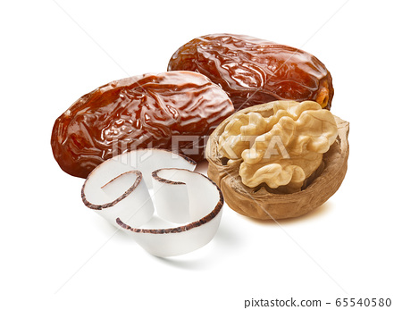 Dates, walnut and coconut curl slices isolated on white background 65540580
