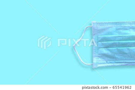Medical mask for corona or covid-19 virus ,safety breathing masks for virus inflection,isolated on blue background, health protection concept,cover mouth and nose to prevent virus,pollution,pm2.5 65541962