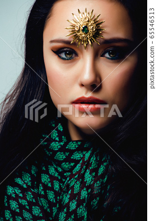 beauty eastern real muslim woman with jewelry close up, bride with star creative makeup 65546513