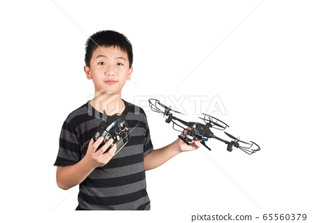 Asian boy holding drone and radio remote control 65560379