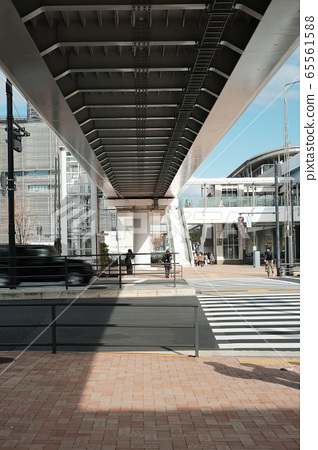 Big city with little people nearby sky train station in Tokyo, Japan 65561588