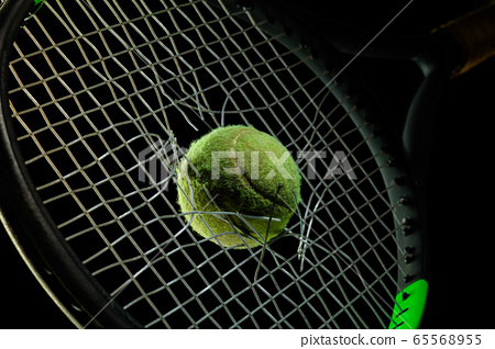 Professional sport equipment isolated on black studio background. Tennis racket and ball. 65568955