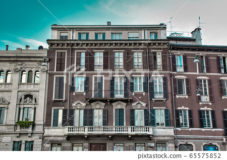 Tradition italian style building with balconies on the streets of Milan 65575852