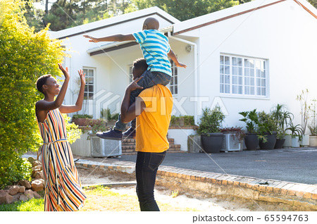 African American family spending time together in their garden. 65594763