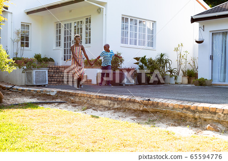 African American woman and her son, spending time together in the garden 65594776
