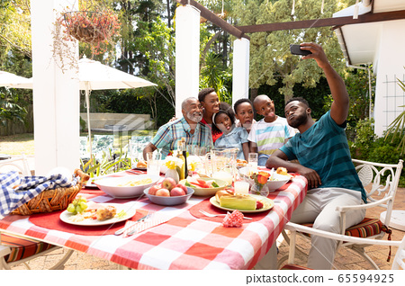 African American family taking a selfie in the garden 65594925