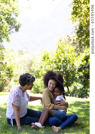 Multi-generation mixed race family enjoying their time at a garden 65595496