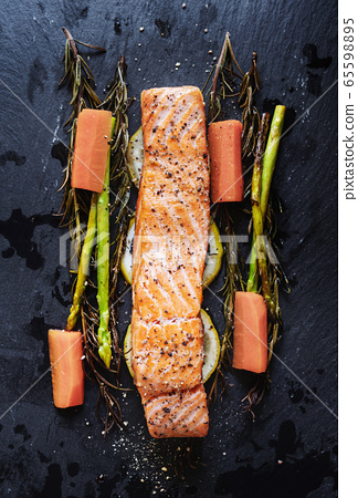 Grilled Salmon baked fillet steak, with lemon, Asparagus, Rosemary and Carrot 65598895