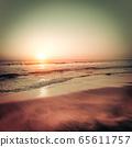 Beautiful sunset at tropical beach. Ocean sandy 65611757