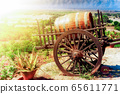 Wooden barrel with vine on cart 65611771