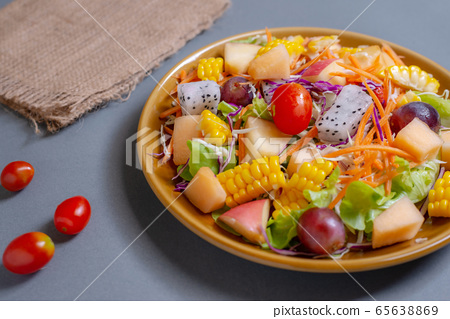 Fruits salad and vegetable in dish plate on gray 65638869