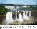 Two lines of Iguazu Falls with rainbow 65639152