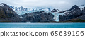 Panorama of cliffs with waterfall and glacier 65639196