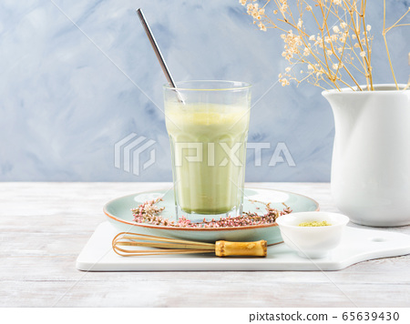 Green matcha tea latte drink in tall glass 65639430
