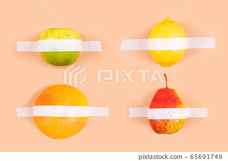 Fruits and sticky tape on a background . 65691749