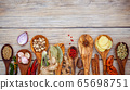 Various of spices and herbs in wooden spoons. Flat 65698751