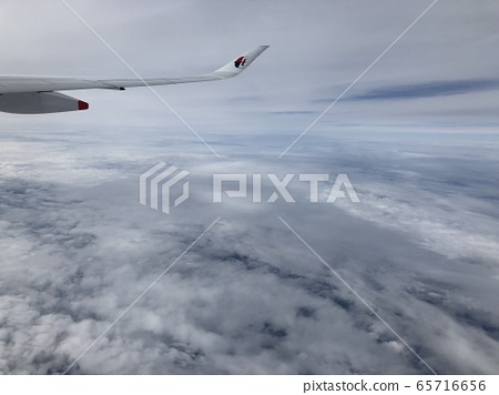 Above the clouds from an airplane 65716656