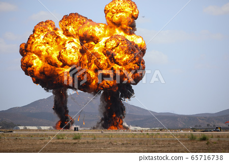 Giant outdoors explosion with fire and black smoke 65716738