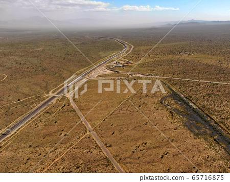 Cargo locomotive railroad engine crossing Arizona desert wilderness. USA 65716875
